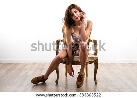 Model woman on armchair - stock photo