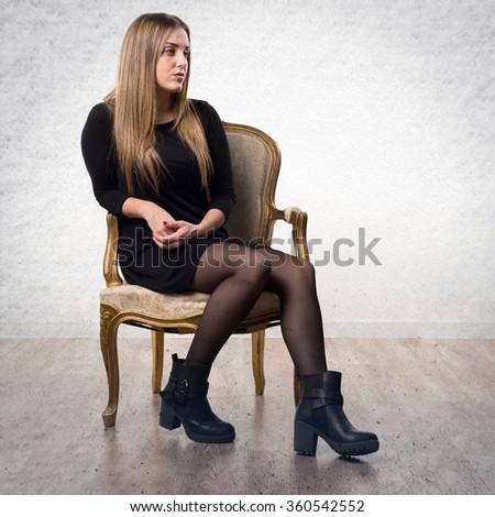 Young cute girl posing vintage armchair stock photo for Sitting in armchair