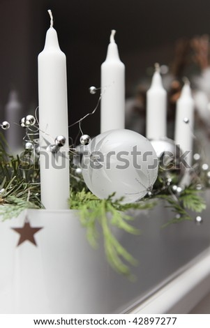 Modern advent wreath with white candles and green - stock photo