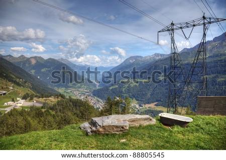 Modern aerial view of swiss alps - powerline, roads and strange bath. - stock photo
