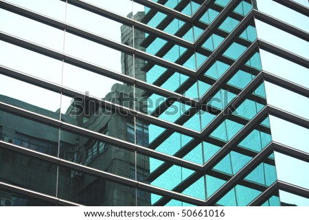 Modern against old - building - stock photo