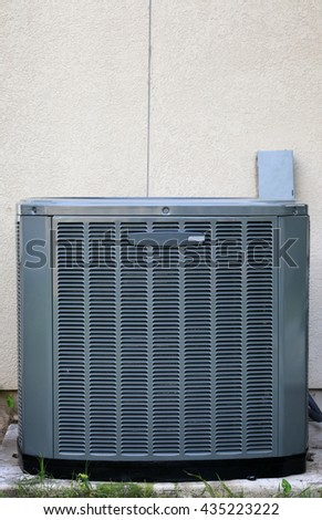 Modern aid conditioner on stucco wall background - stock photo