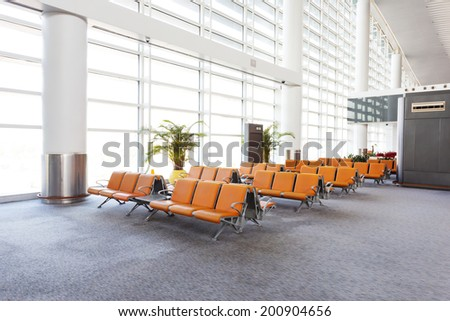 modern airport terminal waiting room - stock photo