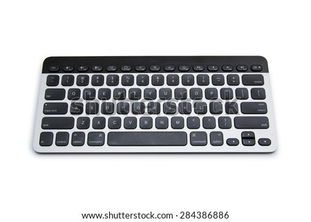 Modern aluminum computer keyboard isolated on white background - stock photo