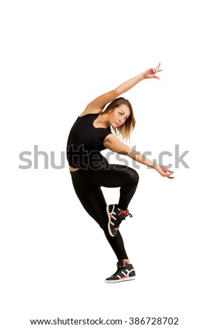 Modern and contemporary style dancer. Young dancer woman in black clothes dancing isolated at white background, studio shot. Girl dancer isolated. Fitness and dance concept. - stock photo