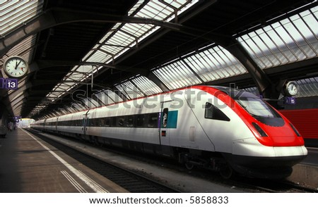 Modern and Fast Commuter Train inside the Depot or Railway Station in Europe. - stock photo
