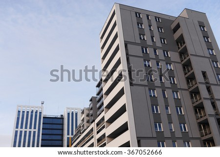 Modern and new apartment building. Multistoried, new and stylish living block of flats. Real estate. house built - stock photo
