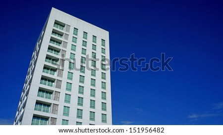 Modern and new apartment building with blue sky - stock photo