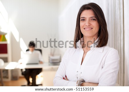 Modern and successful businesswoman at her office