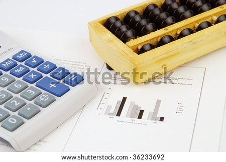 Modern and traditional chinese calculator with a chart in the background - stock photo
