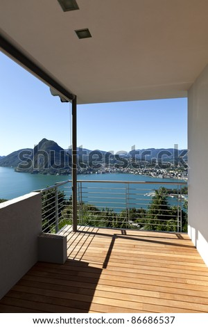 Modern apartment, balcony, lake panoramic view