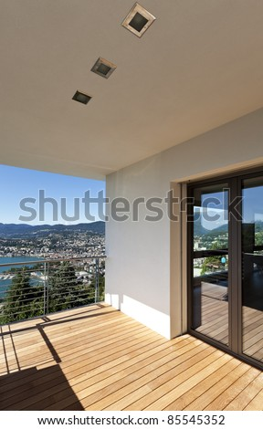 Modern apartment, balcony overlooking the lake - stock photo