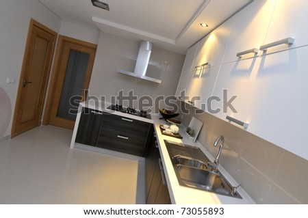 Modern apartment big kitchen with beautiful decoration - stock photo