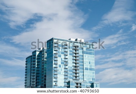 Modern apartment building with blue sky on background - stock photo