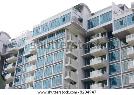 Modern apartment buildings closeup of glass balconies - stock photo