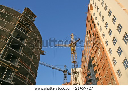 Modern apartment buildings construction site - stock photo