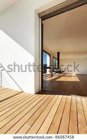 Modern apartment, entrance from the balcony, overlooking the living room - stock photo