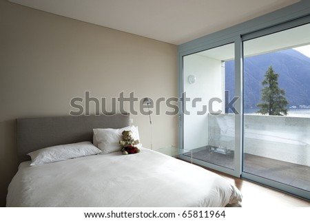 modern apartment interior view, bedroom - stock photo