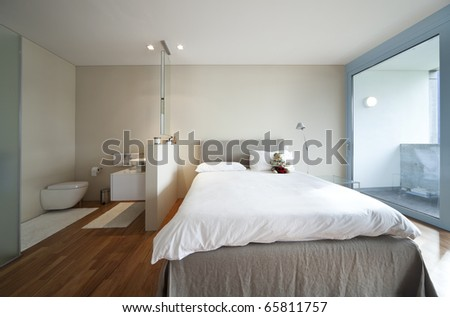 modern apartment interior view, bedroom and bathroom - stock photo