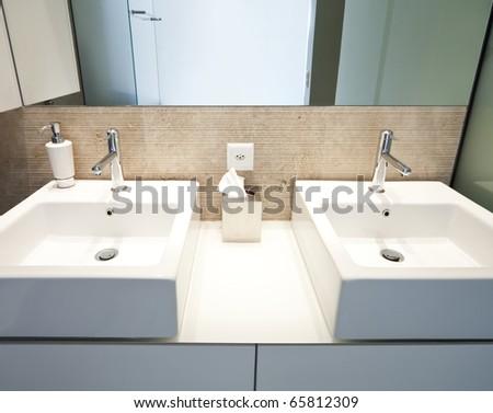 modern apartment interior view, two sinks - stock photo