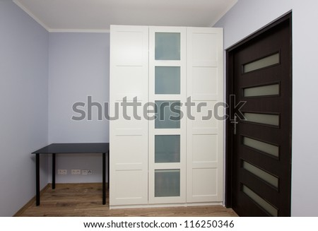 Modern apartment interior with big white  wardrobe - stock photo