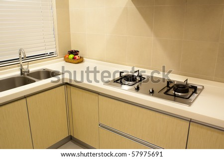 Modern apartment kitchen with aluminum appliances. - stock photo