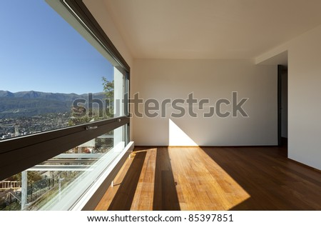 Modern apartment, large living room with panoramic view