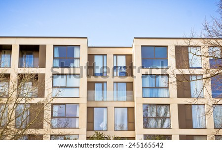Modern apartments against a blue sky - stock photo