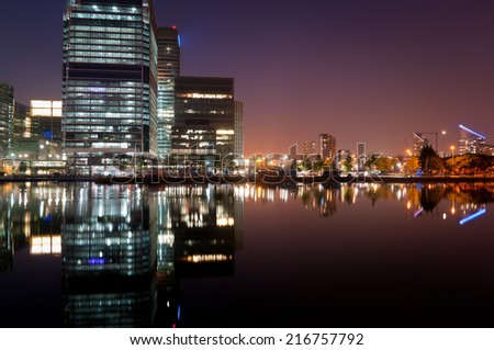 Modern apartments and office buildings in a financial district of London, Canary Wharf - stock photo