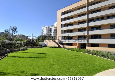 Modern apartments outdoors view with big garden
