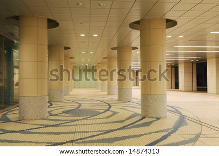 modern architectural background, it is pedestrian walkway space in Tokyo underground area empty at late time