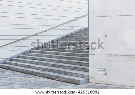 modern architecture concept - close up of urban city stairs with railing - stock photo