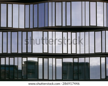 Modern Architecture Facade with City Reflections - stock photo