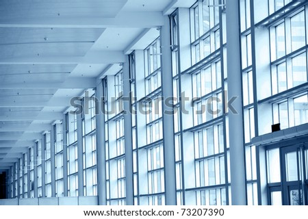 Modern architecture of large business conference center with blue tone.