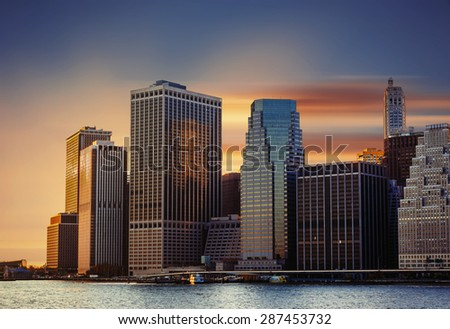 Modern architecture of Manhattan. Sunset in New York City. - stock photo