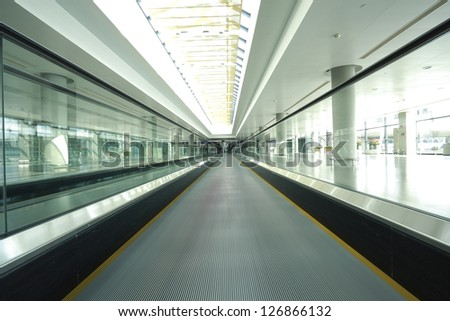 modern architecture steps of moving business escalator - stock photo