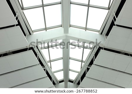 Modern architecture with glass window and roof - stock photo