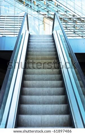 modern architecturel - the escalator moving upwards - stock photo