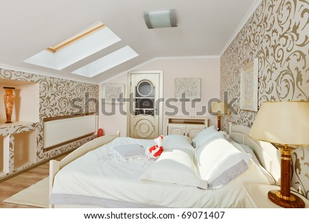 Modern art deco style bedroom interior in light beige colors on loft room - stock photo