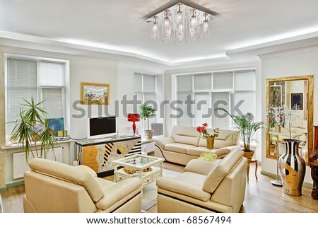 Modern art deco style drawing-room interior with beige leather furniture and TV - stock photo