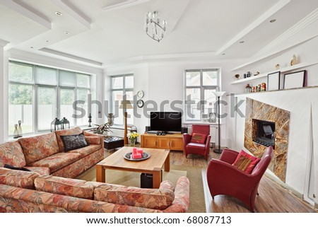 Modern art deco style drawing-room interior with fireplace and TV - stock photo