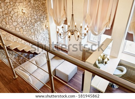 Modern art nouveau style two-high living-room interior with staircase, top view - stock photo