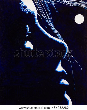 Modern art silhouette portrait of a beautiful woman backlit by the moon light.