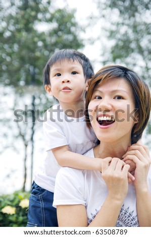 modern asia mother with playing with son - stock photo