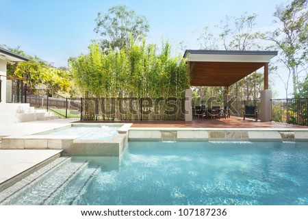 Modern backyard with entertaining area and pool in stylish Australian home - stock photo