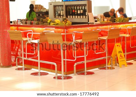 Modern bar in airport. No recognizable faces or brandnames. - stock photo