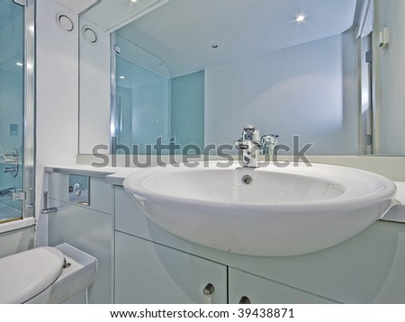 modern bathroom closeup of a ceramic hand wash basin - stock photo