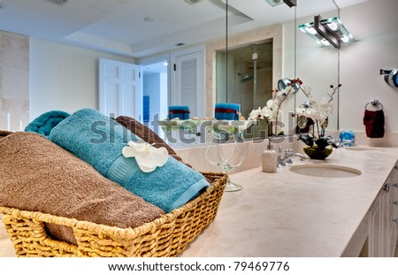 Modern bathroom decorated, focus on towels. - stock photo