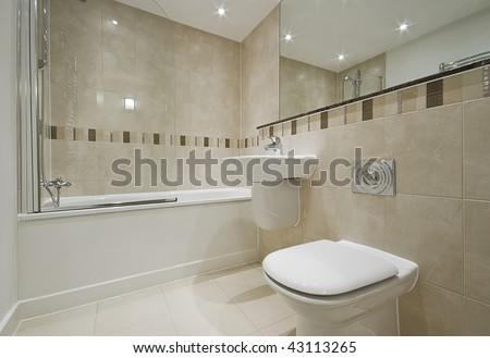 modern bathroom detail with white suite and floor to ceiling tiles - stock photo