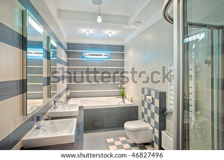 Modern bathroom in blue and gray tones with mosaic on wide angle view - stock photo